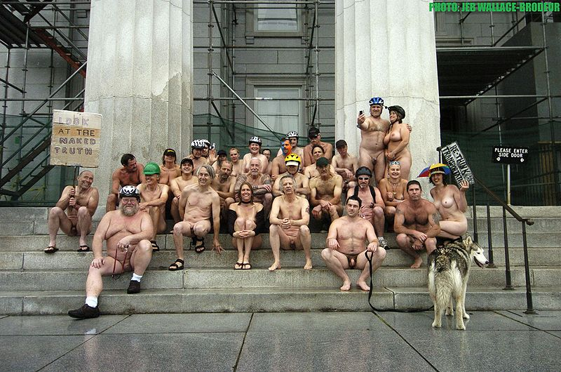 Naked bicycle riders at the Statehouse in Montpelier, Vermont, USA: June 2011.